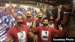 Azerbaijani activists protests against Azerbaijani President Ilham Aliyev's speech at the Council of Europe's Parliamentary Assembly in Strasbourg on June 24.