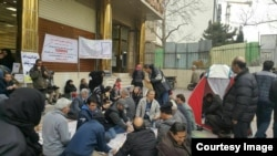 Protesters in front of a Caspian bank branch demand their deposits.