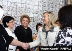Clinton meets Tajik women in downtown Dushanbe on October 22.