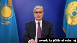Kazakh interim President Qasym-Zhomart Toqaev speaks during a televised address to the nation to call a snap presidential election in Nur-Sultan on April 9.