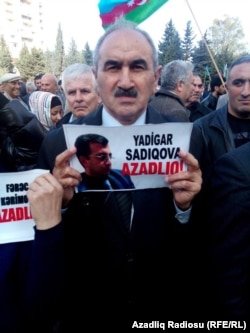 A protester urges the release of activist Yadigar Sadiqov, who is serving a six-year prison sentence.