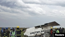 Emergency workers gather at the scene of the crash in Kinshasa.