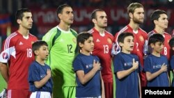 Armenia - Henrikh Mkhitaryan (L) and other Armenia players sing the national anthem before a Euro 2016 qualifying match against Albania, Yerevan, 11Oct2015.