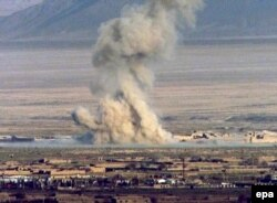 Smoke billows from a bomb dropped by U.S. forces on Taliban positions in October 2001.