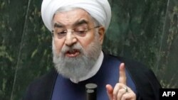 """I see it as unlikely that the IAEA will accept the request for inspections, but even if they do, we will not,"" Iranian President Hassan Rohani said. (file photo)"
