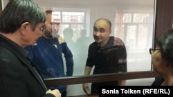 Kazakh activists Maks Boqaev (2nd right) and Talgat Ayan (2nd left) appear in court in Atyrau on November 18.
