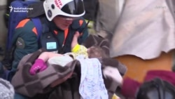 Russian Rescuers Pull Infant From Collapsed Building