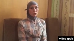Amina Okuyeva and her husband were traveling in a car on the outskirts of the Ukrainian capital on October 30 when a vehicle began chasing them.