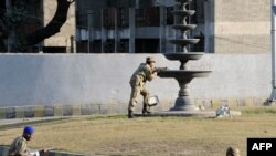 Soldiers take up position outside a besieged mosque in Rawalpindi.