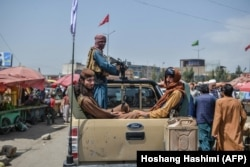 Taliban fighters on the streets of Kabul days after the militant group's takeover of the Afghan capital in August.
