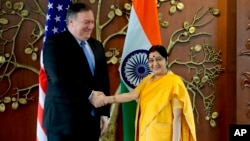 U.S. Secretary of State Mike Pompeo shakes hand with Indian Foreign Minister Sushma Swarah before a meeting in New Delhi on September 6.