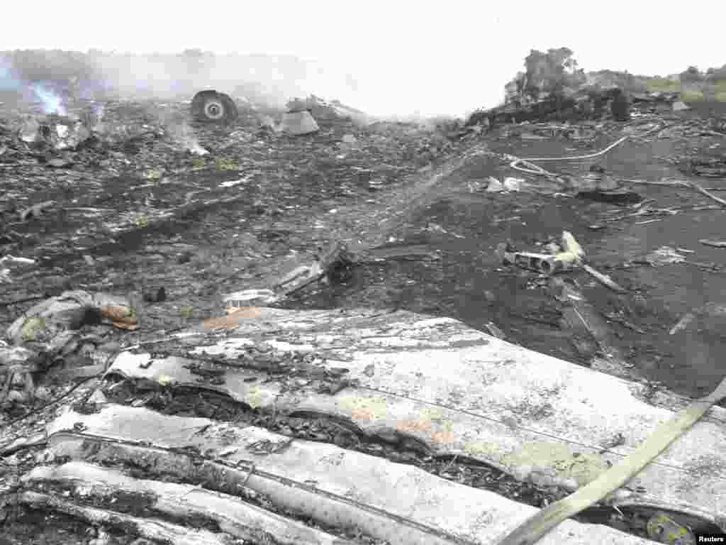 Part of the jetliner's engine is visible amid the wreckage.