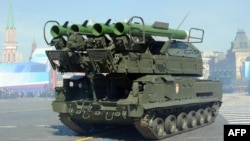 A Russian Buk-2M missile launcher is displayed on Red Square in Moscow during the Victory Day parade on May 9, 2013.