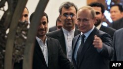 Russian President Vladimir Putin (right) gestures as he speaks with his Iranian counterpart Mahmud Ahmadinejad (left) during a meeting in Beijing in June 2012.