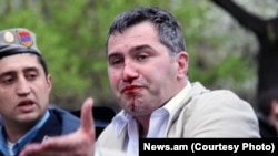 Armenia -- Armen Martirosian, deputy chairman of the opposition Zharangutyun party, is detained by riot police station during an opposition rally in central Yerevan, 9Apr2013.