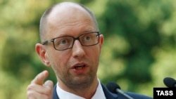 "Ukrainian Prime Minister Arseny Yatsenyuk talks to reporters in Kyiv on August 8 about sanctions proposed by the Cabinet against ""individuals and legal entities financing terrorism and supporting the occupation of Crimea."""