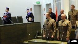 Polish soldiers stand in Poland's top court in Warsaw as they await a judgment on allegations of war crimes in Afghanistan.