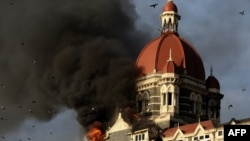 Flames gush out of The Taj Mahal Hotel in Mumbai during the 2008 siege.