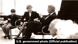 John Kruzel meets with U.S. President Bill Clinton shortly after the death of his father, diplomat Joseph Kruzel.