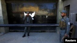 Afghanistan -- Afghan police guard the gate of a guest house after an attack in Kabul May 14, 2015.