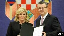 Hrvatska predsjednica Kolinda Grabar Kitarović i mandatar Tihomir Orešković, 23. prosinca 2015.