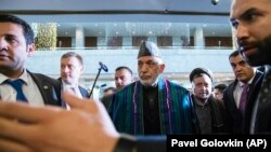 "RUSSIA -- Former Afghan President Hamid Karzai, center, arrives for the ""intra-Afghan"" talks in Moscow, Russia, Tuesday, Feb. 5, 2019."