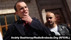Yegor Sobolev (left) became frustrated with journalism and moved into politics.