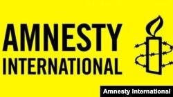 Amnesty International ұйымының логотипі. Көрнекі сурет.