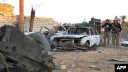 Коопсуздук күчтөрү Рамадинин четки райондорунун биринде. 20-декабрь, 2015-жыл.