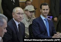 Владимир Путин и Башар Асад на авиабазе Хмеймим в провинции Латакия. Декабрь 2017 года