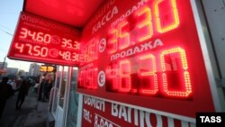 A sign displayed ruble exchange rates in central Moscow on January 30, when Russia's currency fell to a new low.
