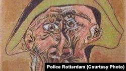 """""""Cap de arlechin"""", tabloul distrus al lui Picasso, într-o fotografie dată publicității de poliție la Rotterdam"""