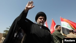 Iraqi Shi'ite cleric Moqtada al-Sadr appeared briefly at the demonstration in Baghdad.