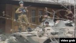 Tajik civil war - Fighters on a tank in Dushanbe