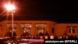 Armenia - Hudreds of people hold a candlelight vigil outside the Harsnakar restaurant in Yerevan, 30Jun2012.