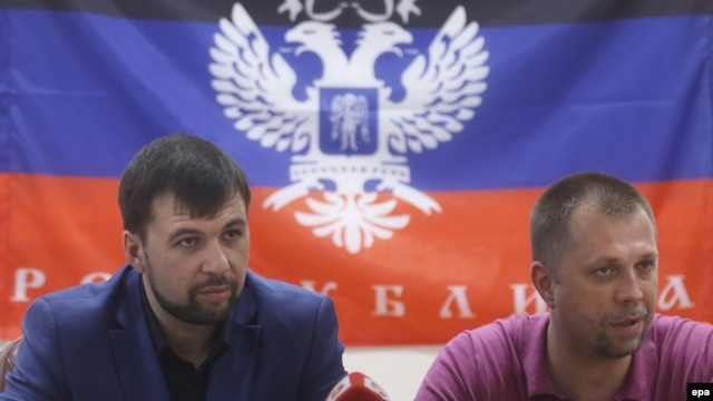 Pro-Russian separatist leaders Denis Pushilin (left) and Aleksandr Borodai in Donetsk, Ukraine, in late May