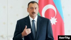 Azerbaijani President Ilham Aliyev presides over a cabinet meeting in Baku on July 12.