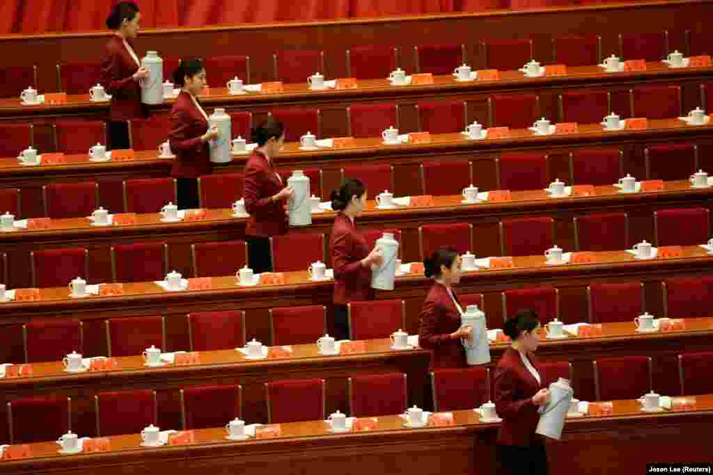 Attendants prepare tea inside the Great Hall of the People before the opening of the 19th National Congress of the Communist Party of China in Beijing. (Reuters/Jason Lee)