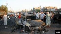 Pamje pas një sulmi të mëparshëm me bombë në pjesën lindore të Bagdadit