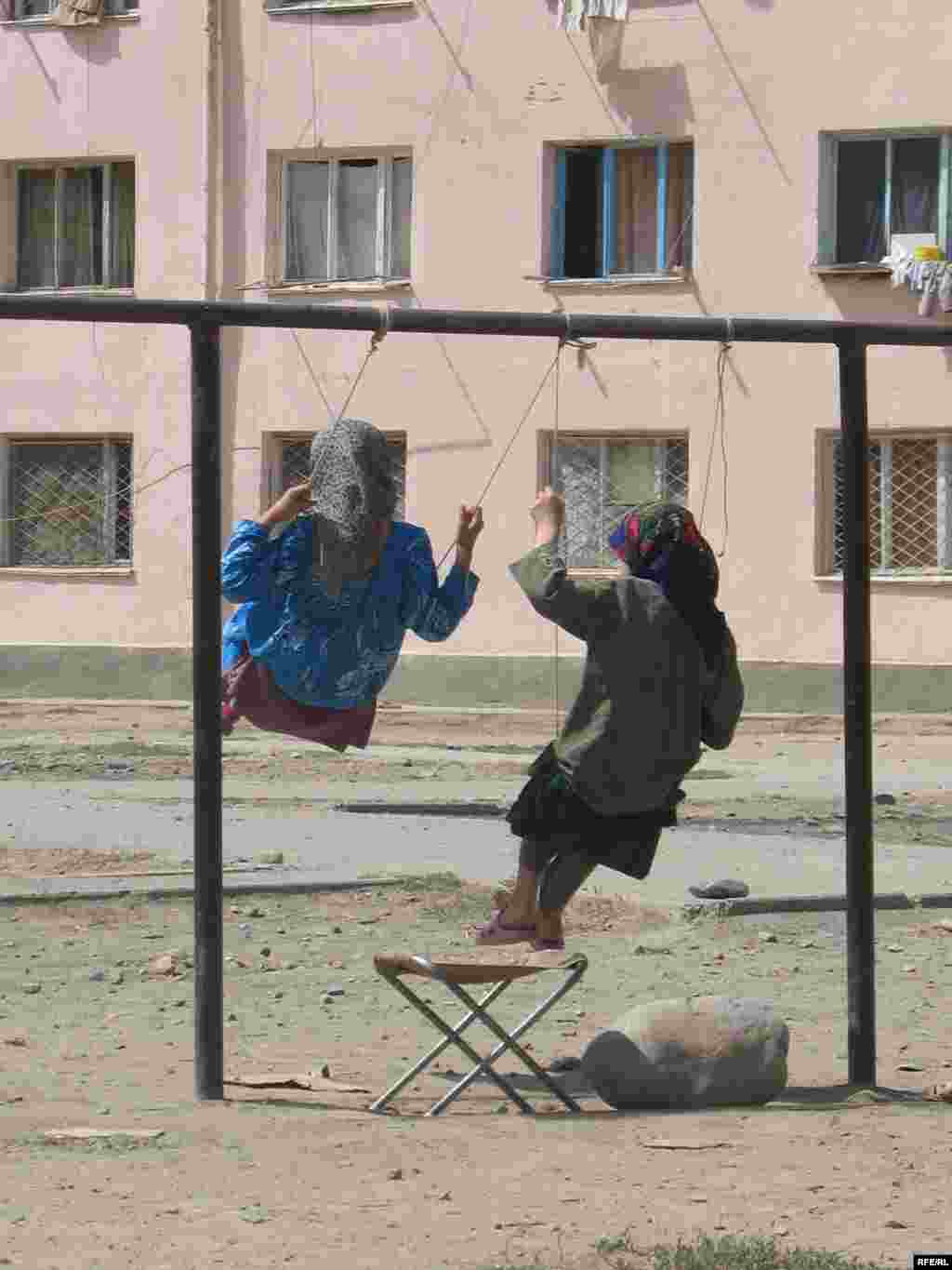 Playtime in a poor area of the capital, Dushanbe.