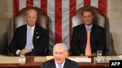 Israeli Prime Minister Binyamin Netanyahu addresses a joint session of the U.S. Congress with Vice President Joe Biden (left) and House Speaker John Boehner in the background.