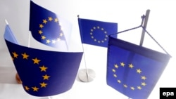 Austria -- EU flags stand on a table during a photo opp at a flag store in Vienna, March 3, 2014