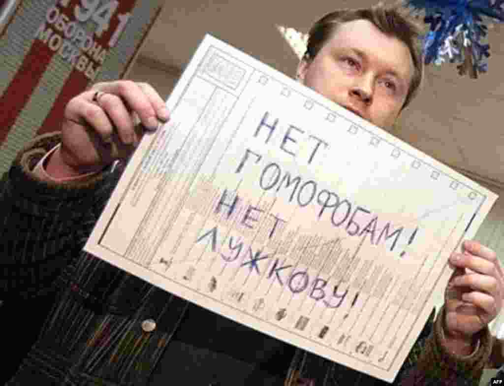 "At a polling station in Moscow, Russian gay community leader Nikolai Alexeyev holds his ballot on which he has written: ""No to Homophobes! No to Luzhkov!"""