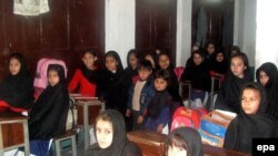 A girls school is reopend after several days of curfew in Swat Valley.