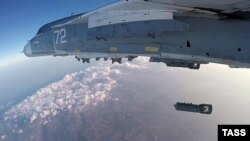 A Russian Sukhoi Su-24M bomber drops a bomb during a combat flight over Syria.