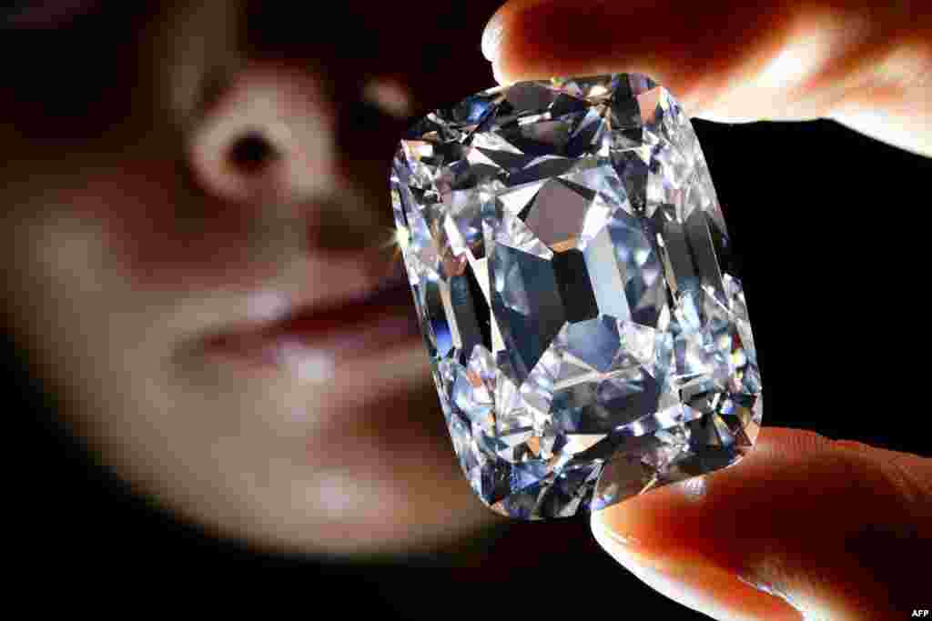 "The 76-carat ""Archduke Joseph"" diamond was sold at auction in Geneva on November 13 for more than $21 million -- a world-record price per carat for a colorless diamond. Once part of the collection of Archduke Joseph of Austria (1872-1962), the diamond was mined at the legendary Indian Golkonda mine. (AFP/Fabrice Coffrini)"