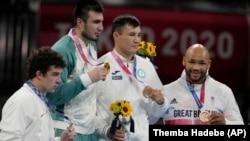 JAPAN - Silver medal winner Richard Torrez Jr., from the United States, left, Gold medal winner Uzbekistan's Bakhodir Jalalov, second from left, bronze medalists Kazakhstan's Kamshybek Kunkabayev, third from left, and Britain's Frazer Clarke, right, durin