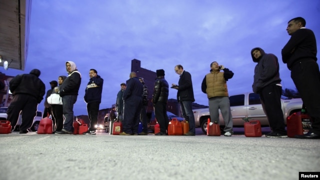 People wait for gas at a Hess fueling station in Brooklyn on November 2.