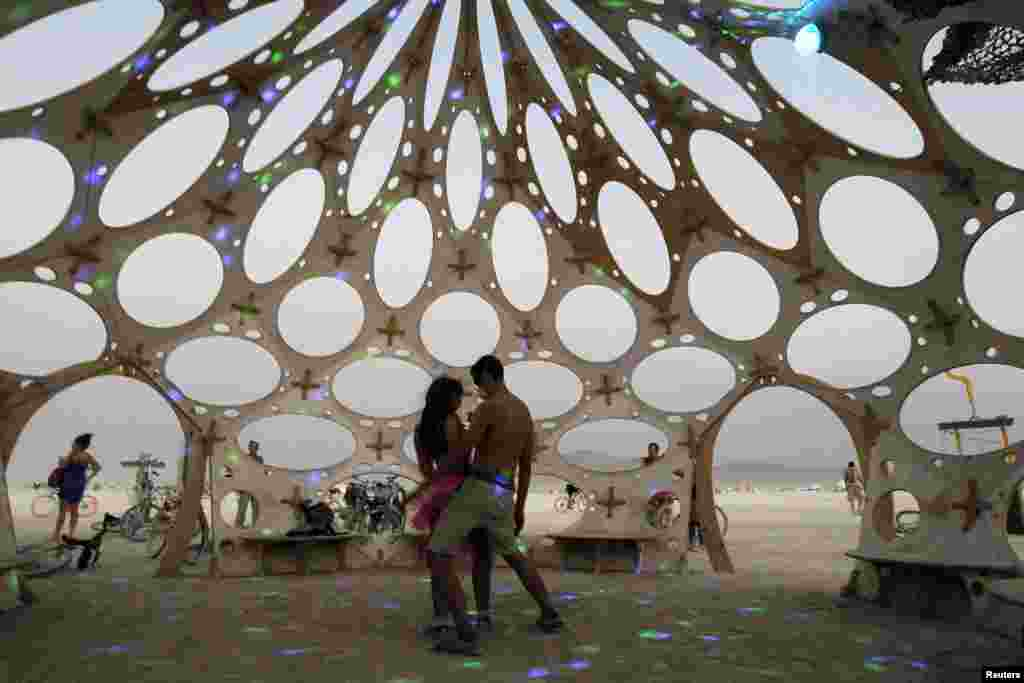 Festival-goers dance in a special dome during the 2013 Burning Man arts and music festival in Nevada.