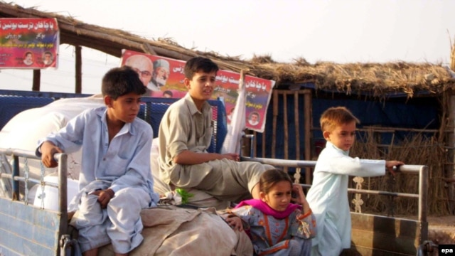 Pakistani refugees preparing to go back to Swat at a refugee camp on the outskirts of Peshawar